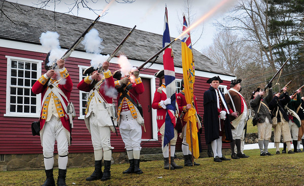 Byfield: His Majesty's 10th Regiment fire their muskets at the opening of ceremonies marking the 250th Anniversary of the opening of The Governor's Academy in Byfield on Friday. The original schoolhouse is in the back. Bryan Eaton/Staff Photo