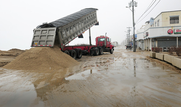 Salisbury: Truckloads of beach sand were dumped at Salisbury Beach along the commercial areas in anticipation of storm tides Thursday night and Friday morning. Bryan Eaton/Staff Photo