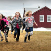 """Newburyport: The Inn Street Montessori School took their gym class to the Newburyport Waterfront during Tuesday's relatively nice weather. Here they play a game of """"march and attack"""" to limber up before doing other activities. Bryan Eaton/Staff Photo"""