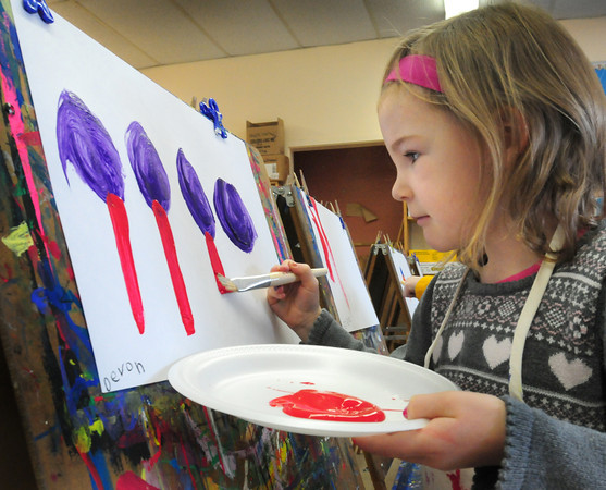 Newburyport: Devon Davis, 5, creates a painting of the Brown School playground in Pam Jamison's class at that school Tuesday morning. Children were learning the rainbow colors of the color wheel to make their creations, hers being the monkey bars. Bryan Eaton/Staff Photo