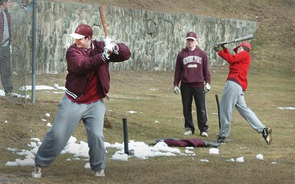 Newburyport: Newburyport High School baseball players at batting practice on Monday. Bryan Eaton/Staff Photo