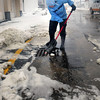 Salisbury: Andy Scott and some of her friends spent time clearing drains on Central Avenue at Salisbury Beach to allow seawater that flowed over to drain. Bryan Eaton/Staff Photo