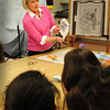 Newburyport: Susan Spellman shows Newburyport art students how to make a mockup book in an Illustrative Workshop afterschool. The art department has been inviting guest artists from the Newburyport Art Assocation to give the workshops. Bryan Eaton/Staff Photo
