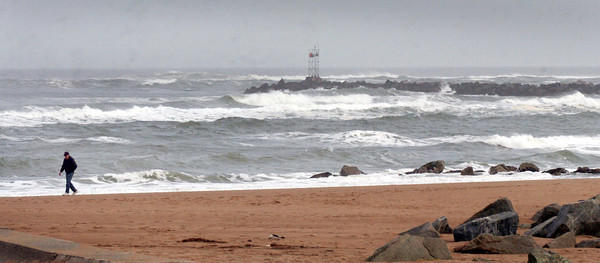 Salisbury: Strong waves are still coming to shore, here, at Salisbury Beach State Reservation on Monday afternoon. Bryan Eaton/Staff Photo