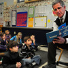 "Amesbury: Amesbury police detective Robert Wile reads ""The Cat in the Hat"" to first-graders at Cashman Elementary School on Monday for Read Across America where guests readers come to schools. Bryan Eaton/Staff Photo"