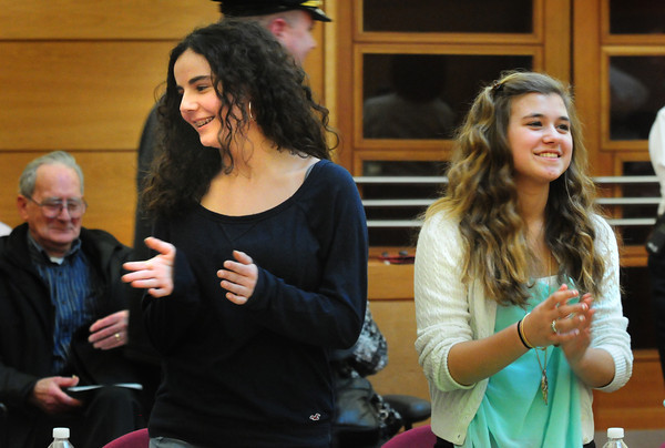 Newburyport: Alexa Reilly, playing Suzie Smith, left, with defense team member Dayna Rybicki, smiles as the jury came back without a decision in the mock trial. Bryan Eaton/Staff Photo