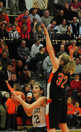 Beverly: Pentucket's Tess Nogueira goes for a layup as Ipswich's Julia Davis covers last night at Beverly High School. Bryan Eaton/Staff Photo