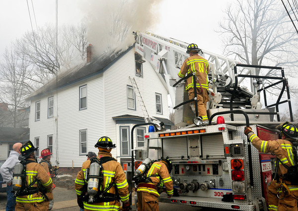 Amesbury: Firefighters quickly got under control a two-alarm fire at 9 Huntington Street in Amesbury last Tuesday morning. Several towns provided mutual aid for the fire that seemed to start in the attic of this two and a half story home off Elm Street. Bryan Eaton/Staff Photo