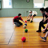 Newburyport: Youngsters scramble during the beginning of a dodgeball game at the Kelley School Drop-In Center on Tuesday afternoon. Earlier they made mini cupcakes. Bryan Eaton/Staff Photo