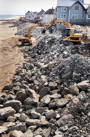 Newbury: Truckloads of stone have been deposited on the beach south of Plum Island Center to prevent further danger to homes that have survived recent storms. Photo is looking south from the deck of Bob Connors' home at 39 Annapolis Way. Bryan Eaton/Staff Photo