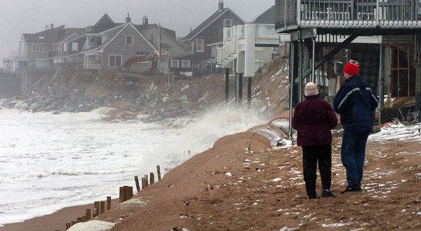 Newbury: Waves hit the giant sandbags at Plum Island in the Annapolis Way area yesterday afternoon about two hours before the high tide. Bryan Eaton/Staff Photo