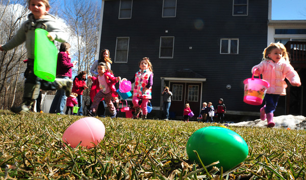 Salisbury: Youngsters head out from Little Inspirations Daycare in Salisbury on Wednesday during their annual Easter Egg Hunt. The more eggs they find, the more pieces of candy they bring home after they open the eggs for the sweets. Bryan Eaton/Staff Photo
