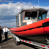 Newburyport: Newburyport Harbormaster Paul Hogg, far left, shows off the new boat to safety officials, from left,  acting Fire Chief William Shute, police Senior Lt. Rick Siemasko and fire department Deputy Chief Steve Bradbury. Bryan Eaton/Staff Photo