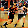 Beverly: Ipswich's Masey  Zegarowski moves down court as Pentucket's Alex Moore moves in to cover. Bryan Eaton/Staff Photo