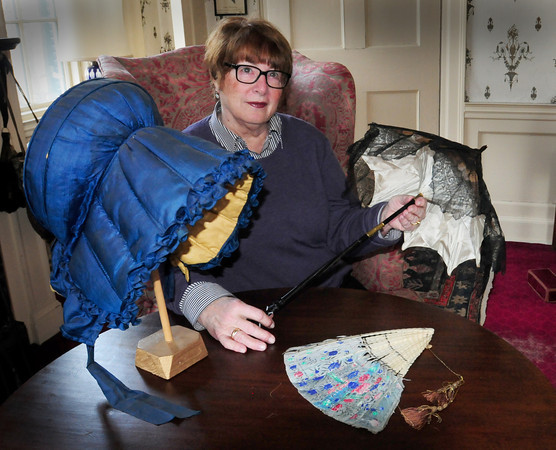 Newburyport: Speaker Lois Valeo with a bonnet from 1815-1830, left, and a parasol circa 1830. Bryan Eaton/Staff Photo