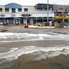 Salisbury: Some seawater spilled over Broadway at Salisbury Beach Center at high tide Thursday morning, but there were no reports of damage from that tide. Officials had more concern about the evening and Friday morning high tides. Bryan Eaton/Staff Photo