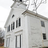 Seabrook: The Old South Meetinghouse at Routes 1 and 107 in Seabrook has fallen into disrepair, with some rotting wood and in need of a paint job. Bryan Eaton/Staff Photo