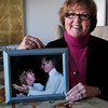 Salisbury: Connie Wilder holds a photo of her and her late husband. Bryan Eaton/Staff Photo