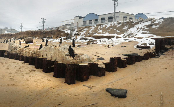 Salisbury: Some remnants of structures at the top of Broadway at Salisbury Beach Center have been unearthed by the storm. Bryan Eaton/Staff Photo
