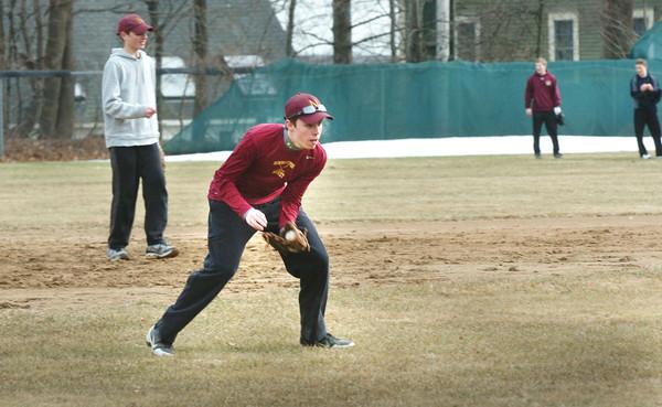 Newburyport: Newburyport High players field balls as spring sports practice began Monday. Bryan Eaton/Staff Photo