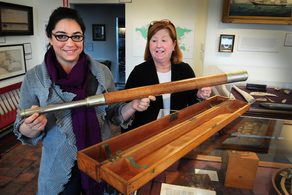 Newburyport: Michelle Hastings, left, and Cynthia Muir of the Custom House Maritime Museum with a historic telescope found in their collection. Bryan Eaton/Staff Photo