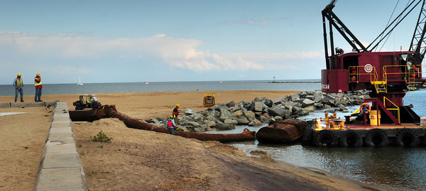 Salisbury: Equipment from the dredging of the Merrimack River in October of 2010 pulled right up to the western terminus of the north jetty at Salisbury Beach State Reservation. Bryan Eaton/Staff Photo