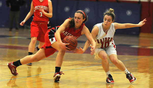 Watertown: Amesbury'sEmily Martin protects the ball from Watertown's Gabriella Coppola during the Indians loss to Watertown at Watertown high school Sunday. Jim Vaiknoras/staff photo