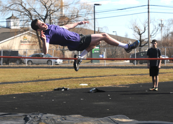Newburyport: Tom Graham practices the high jump at Newburyport high track practice at Fuller Field. Jim Vaiknoras/staff photo