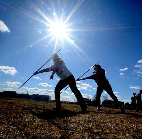 Newburyport: Seniors Alex Edwards and Alex Muise practice the javelin at Newburyport high track practice at Fuller Field. Jim Vaiknoras/staff photo