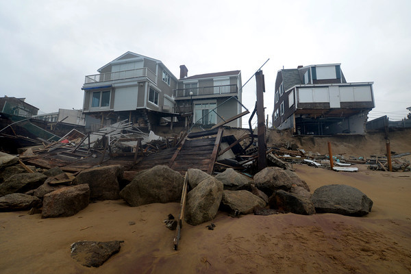 Newbury:The ocean side of 35 and 37 Fordham Way was damaged at high tide. Jim Vaiknoras/staff photo
