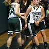 West Newbury: Pentucket's Alex Moore, #11, is helped up after by teammates Emily Dresser #44 , and Sydney Snow after she is fouled against Bishop Fenwick during their game at Pentucket Saturday afternoon. JIm Vaiknoras/staff photo
