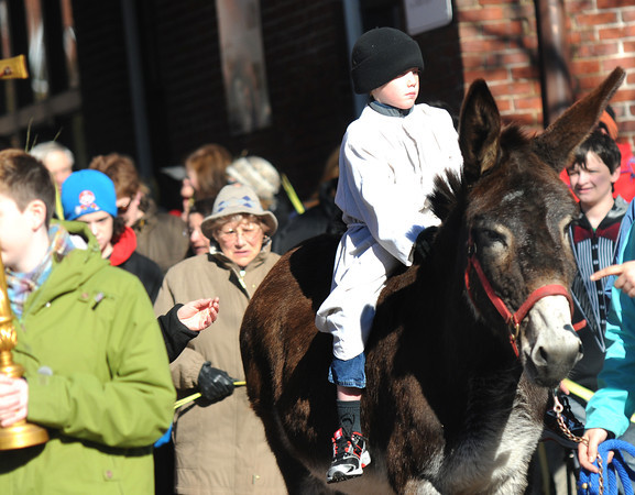 amesbury: Patrick Kelleher, 7, rides Mary the donkey at the annual Palm Sunday procession on Main Street in Amesbury Sunday morning. The event was sponsored by the Amesbury Council of Churches. Jim Vaiknoras/staff photo