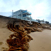 Newbury: The remnants of sandbags in front of Blu on Plum Island were damaged at high tide. Jim Vaiknoras/staff photo