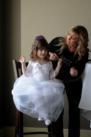 Salisbury: Olivia Thomas , 3, of Methuen get her hair done by Ann Marie Lewis of Skyy Salon in Salisbury at the seaglass Princess Brunch at Seaglass on Salisbury Beach Sunday morning. JIm Vaiknoras/staff photo