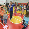Amesbury: Parent Jill Prescott leads the cake walks at the annual Family Fun Fair at the Cashman School in Amesbury Saturday afternoon. Jim Vaiknoras/staff photo