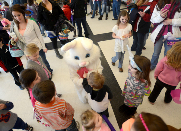 salisbury:The Easter Bunny greets kids at the Salisbury Elementary School Saturday during the annual Easter Egg Hunt put on by the Salisbury Parks and Recreation Commission.