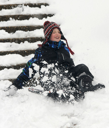 Newburyport: Zack Engelhardt kicks up some snow as he sleds on Marches Hilll iN Newburyport Tuesday. Zack, along with his friend Casey Holmes  took advantage of a day off from school due to the snow. Jim Vaiknoras/staff photo