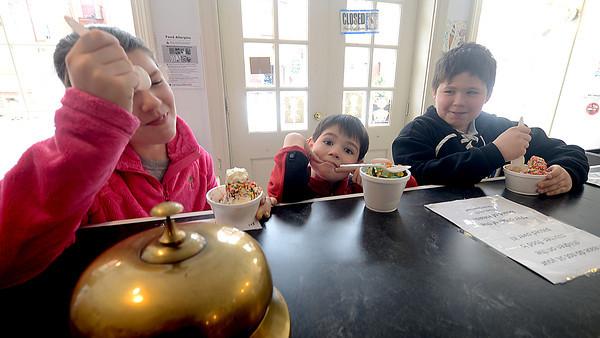 Newburyport: Maddie Dahn, 11, of newburyport, enjoys a laugh and an ice cream with her brothers , Garret, 6, and harrison, 9, at Simply Sweet on Inn Street in Newburyport Thursday. Jim Vaiknoras/staff photo