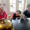 Newburyport: Maddie Dahn, 11, of newburyport, enjoys a laugh and an ice cream with her brothers , Garret, 6, and harrison, 9, at Simply Sweet on Inn Street in Newburyport Thursday. Jim Vaiknoras/staff photo