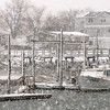 Seabrook: Snow falls on the docks and boats at Seabrook Harbor Tuesday morning. Jim Vaiknoras/staff photo