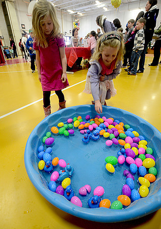 Amesbury: Casey Metcalf, 6, and her sister Marley , 4, try to pick Luckey Ducks at the annual Family Fun Fair at the Cashman School in Amesbury Saturday afternoon. Jim Vaiknoras/staff photo