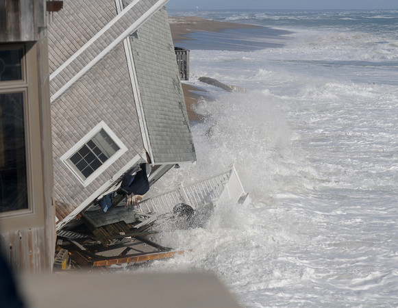 Newbury: 31 Annapolis on Plum Island ,which fell over early Saturday morning, is pounded by the surf at high tide later Saturday. Jim Vaiknoras/staff photo