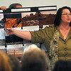 Newbury: Plum Island resident Cheryl Jones talks about efforts taken in the 1970's to protect the beach at the Coastal Hazard Mitigation Meeting at the Fireman's Memorial Hall in Newbury Tuesday night. Jim Vaiknoras/staff photo