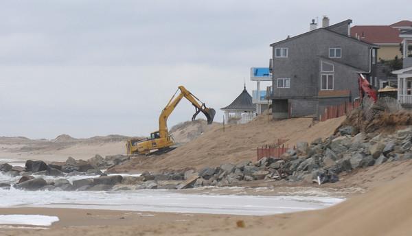 Newbury: An excavator works on the beach south of the Plum Island Beach center. Jim Vaiknoras/staff photo