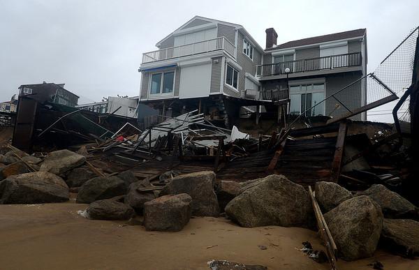 Newbury:The ocean side of 35 Fordham Way was damaged at high tide. Jim Vaiknoras/staff photo
