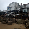 Newbury:The ocean side of 35 Fordham Way was damaged at high tide. Jim Vaiknoras/staff photo