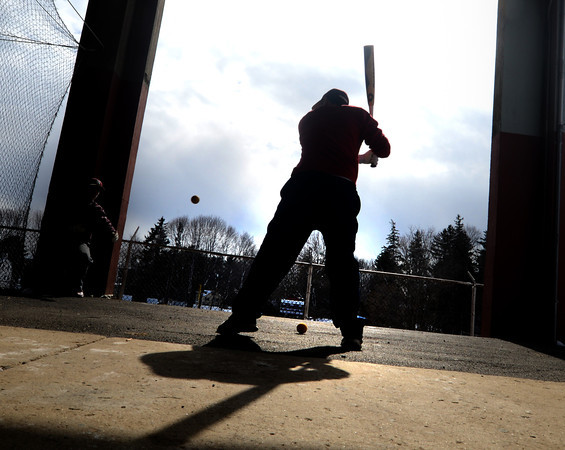 Newburyport: Newburyport high baseball player Evan Habib takes a few swings during practice behind War Memorial Stadium Friday. Practice was held there because everything else was covered with snow. Jim Vaiknoras/staff photo