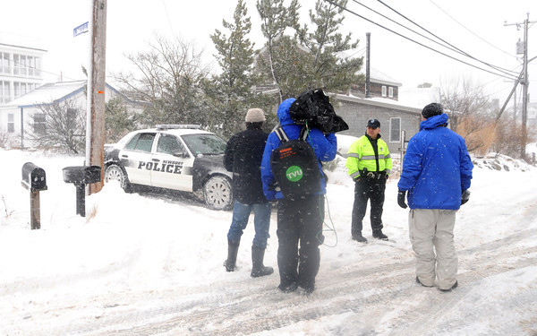 Newbury:A Newbury police office stops members of the media from heading up Annapolis Way on Plum Island. The high tide from the storm knocked the house at 41 off it's foundation. Jim Vaiknoras/staff photo
