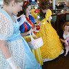 Salisbury: Vanessa Murray, 15 month, of Londonderry along with her mom Nicole, say hi to , Sarah Moffitt of Marblehead as Cinderella, Maryanne Truax of Salem, as Snow White, and Cassie Adams of Amesbury as Belle at the seaglass Princess Brunch at Seaglass on Salisbury Beach Sunday morning. JIm Vaiknoras/staff photo
