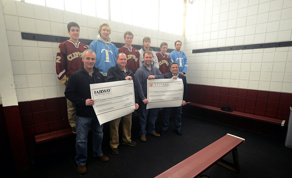 Newburyport: Donation checks for renovating locker rooms at the Graf Rink in Newburyport. Jim Vaiknoras/staff photo